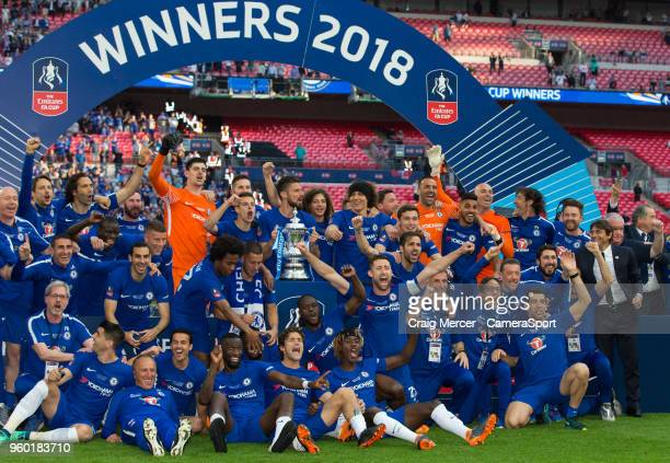 Chelsea players celebrate with the trophy after the Emirates FA Cup Final match between Chelsea and Manchester United at Wembley Stadium on May 19,...