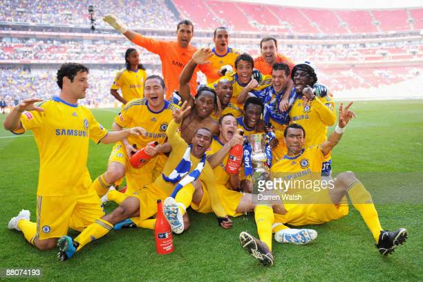 Chelsea players celebrate with the trophy after the FA Cup sponsored by EON Final match between Chelsea and Everton at Wembley Stadium on May 30 2009...