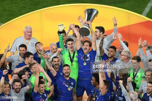 Chelsea players celebrate with the trophy after the UEFA Europa League final football match between Chelsea FC and Arsenal FC at the Baku Olympic...