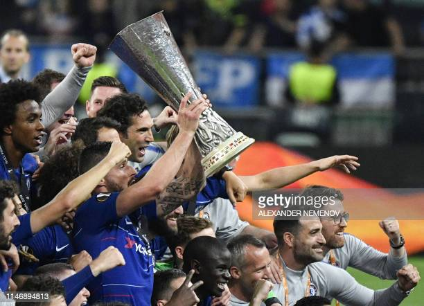 TOPSHOT Chelsea players celebrate with the trophy after the UEFA Europa League final football match between Chelsea FC and Arsenal FC at the Baku...