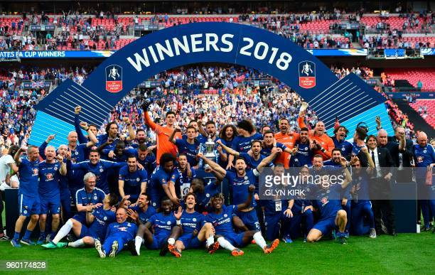 Chelsea players celebrate with the trophy after their victory in the English FA Cup final football match between Chelsea and Manchester United at...
