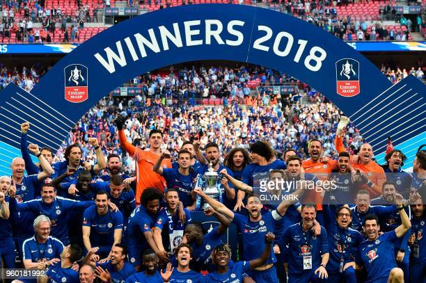 TOPSHOT Chelsea players celebrate with the trophy after their victory in the English FA Cup final football match between Chelsea and Manchester...