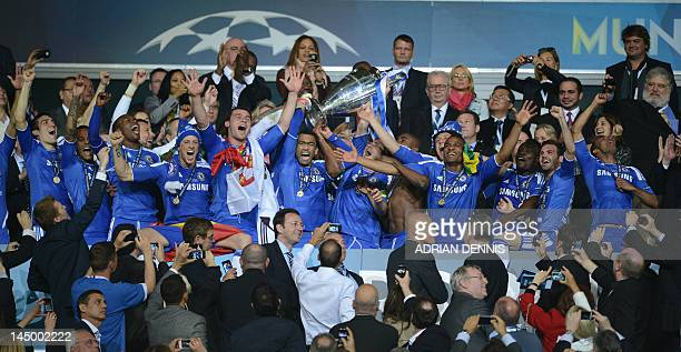 Chelsea players celebrate with the trophy after winning the UEFA Champions League final football match between FC Bayern Muenchen and Chelsea FC on...