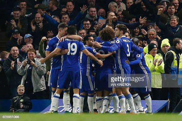 Chelsea players celebrates after Chelsea's Nigerian midfielder Victor Moses scored their second goal during the English Premier League football match...