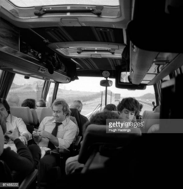 Chelsea players Clive Walker and Gary Chivers relax on the team coach on the way to an away match during the 1981/82 season travelling along the M1...