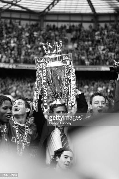Chelsea players Didier Drogba Frank Lampard manager Jose Mourinho and John Terry celebrate with the league trophy as they celebrate winning the...