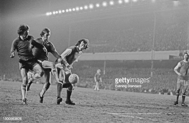 Chelsea players Eddie McCreadie and Marvin Hinton, and Arsenal defender Peter Storey, during an FA Cup Quarter-final replay match at Highbury Stadium...