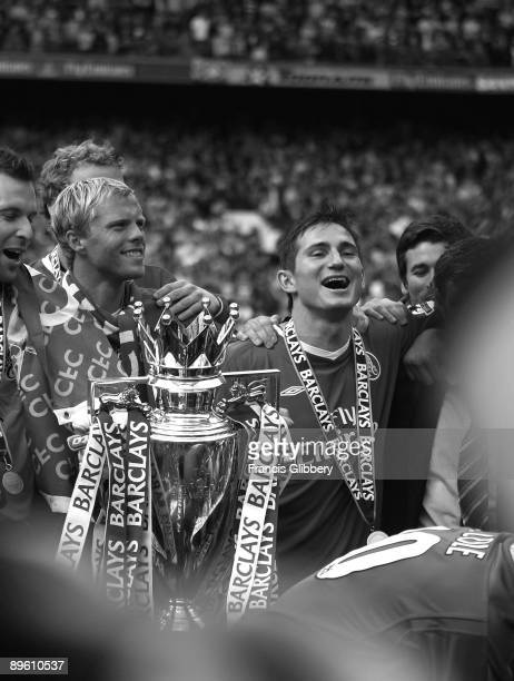 Chelsea players Eidur Gudjohnsen and Frank Lampard celebrate with the league trophy as they celebrate winning the league title after the FA Barclays...