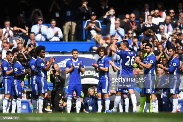 Chelsea players form a guard of honour as John Terry of Chelsea leaves the pitch for the final time following an injury during the Premier League...