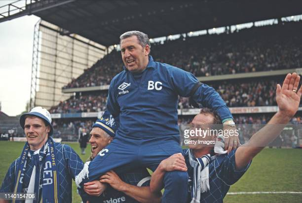 Chelsea players from left Gordon Durie Graham Roberts and Peter Nicholas hoist manager Bobby Campbell onto their shoulders after gaining promotion to...