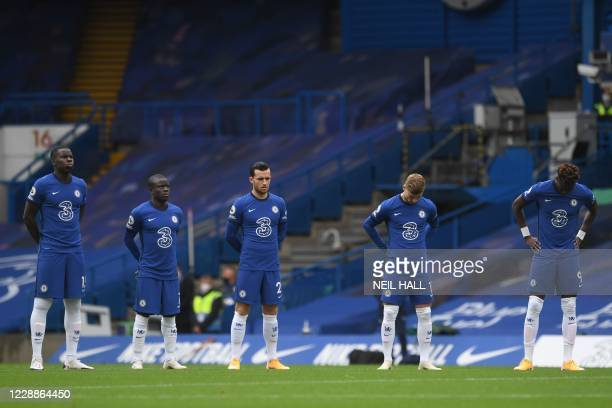 Chelsea players hold a minute's silence before the English Premier League football match between Chelsea and Crystal Palace at Stamford Bridge in...