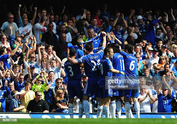 Chelsea players hold up a shirt in tribute to the mother of Frank Lampard as Michael Ballack scores during the Barclays Premier League match between...