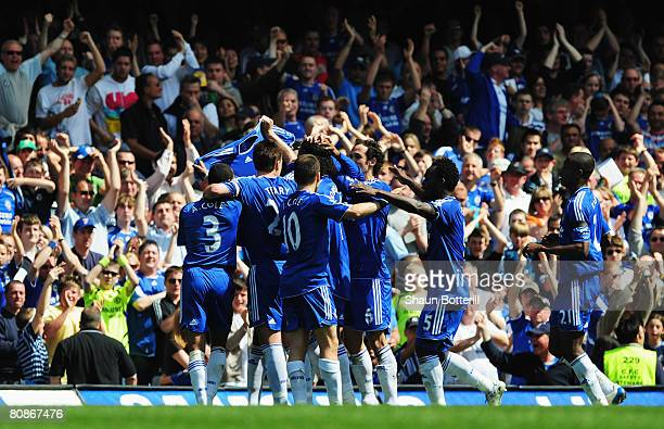 Chelsea players hold up a shirt in tribute to the mother of Frank Lampard as Michael Ballack scores their first goal during the Barclays Premier...