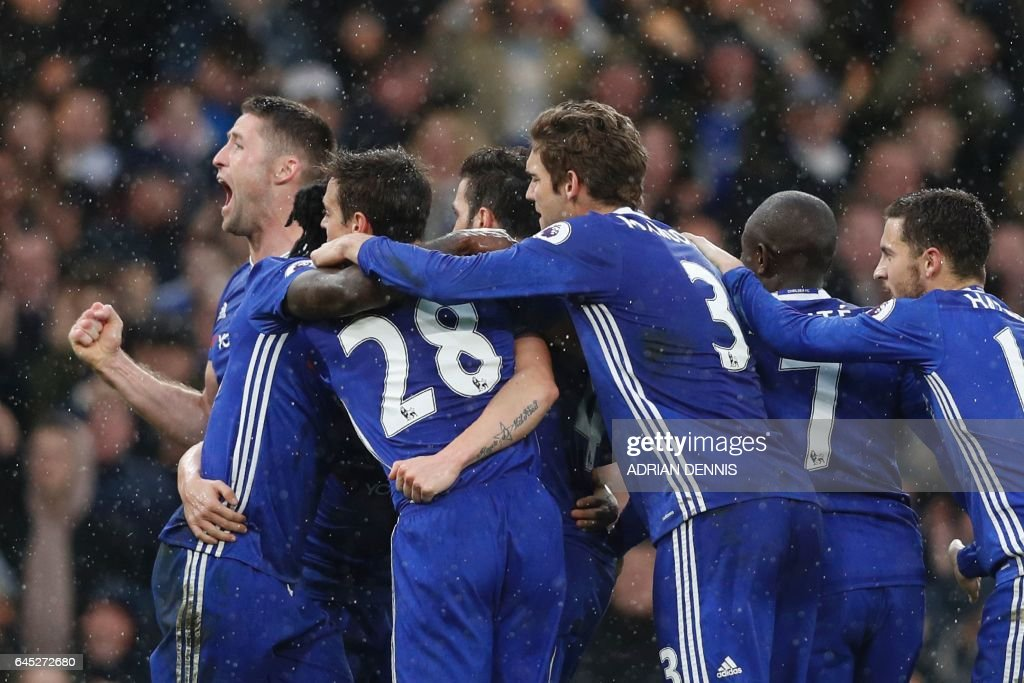 Chelsea players including Chelsea's English defender Gary Cahill (L) celebrate their second goal scored by Chelsea's Spanish midfielder Pedro during the English Premier League football match between Chelsea and Swansea at Stamford Bridge in London on February 25, 2017. / AFP / Adrian DENNIS / RESTRICTED TO EDITORIAL USE. No use with unauthorized audio, video, data, fixture lists, club/league logos or 'live' services. Online in-match use limited to 75 images, no video emulation. No use in betting, games or single club/league/player publications. /