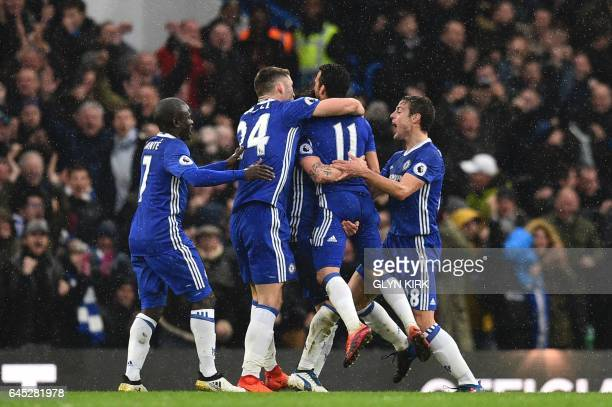 Chelsea players including Chelsea's French midfielder N'Golo Kante Chelsea's English defender Gary Cahill and Chelsea's Spanish defender Cesar...