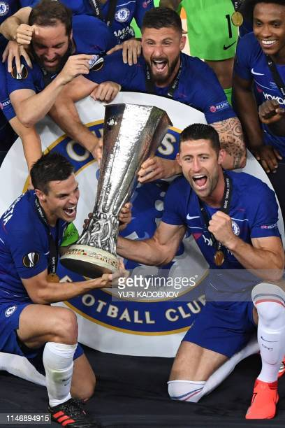 Chelsea players including Chelsea's Spanish defender Cesar Azpilicueta and Chelsea's English defender Gary Cahill celebrate with the trophy after the...