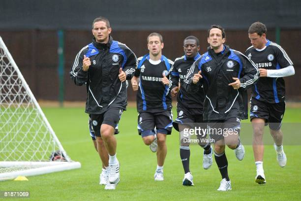 Chelsea players including Juliano Belletti Frank Lampard jogging during a training session July 9 2008 in Cobham England