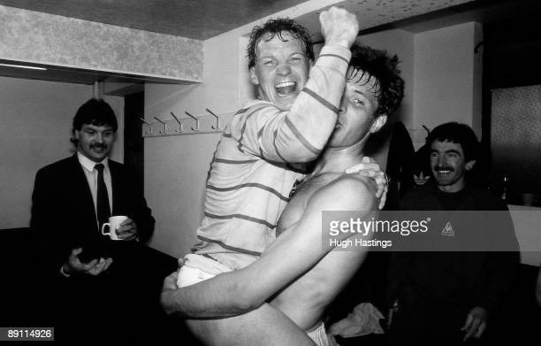 Chelsea players Joe McLaughlin and David Speedie celebrate winning the Second Division Championship in the Chelsea dressing room after the English...