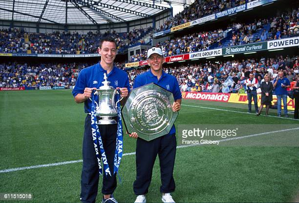 Chelsea players John Terry and Jon Harley with the FA Cup and FA Community Shield