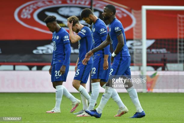 Chelsea players leave the pitch after the English Premier League football match between Sheffield United and Chelsea at Bramall Lane in Sheffield,...