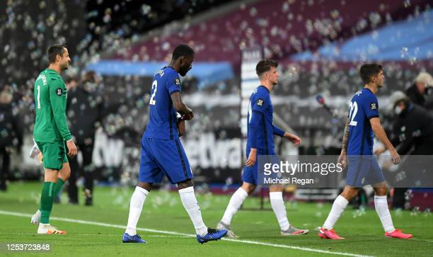 Chelsea players leave the pitch dejected following the Premier League match between West Ham United and Chelsea FC at London Stadium on July 01, 2020...