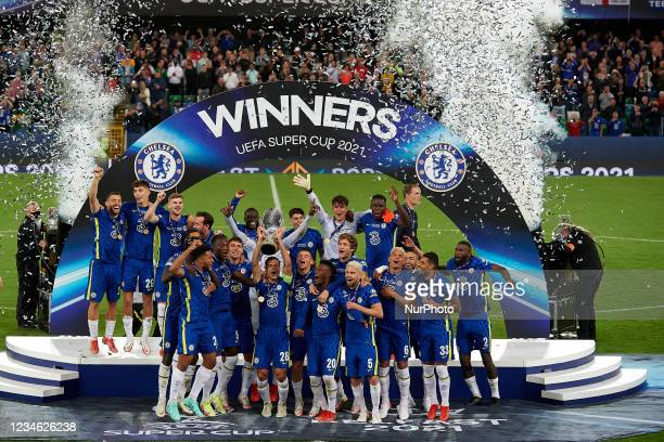 Chelsea players lift the trophy after winning with his team the UEFA Super Cup Final match between Chelsea CF and Villarreal CF at Windsor Park on...