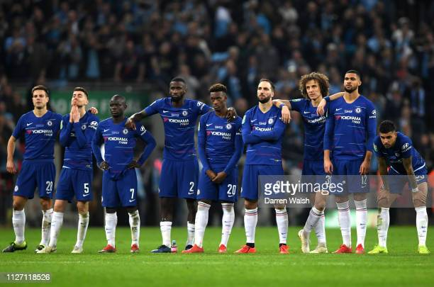 chelsea players look dejected during the penalty shoot out in the Carabao Cup Final between Chelsea and Manchester City at Wembley Stadium on...
