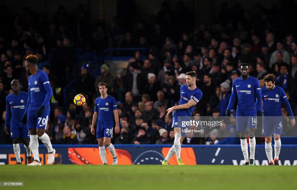 Chelsea players look dejected during the Premier League match between Chelsea and AFC Bournemouth at Stamford Bridge on January 31, 2018 in London, England.