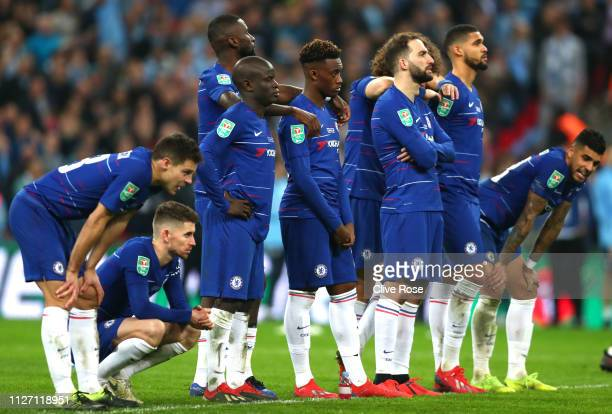 Chelsea players look on during the penalty shoot out in the Carabao Cup Final between Chelsea and Manchester City at Wembley Stadium on February 24,...
