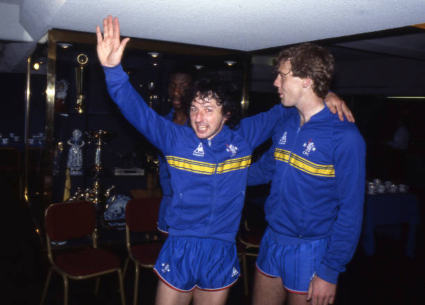Chelsea players Mickey Thomas and Kerry Dixon celebrate promotion to the First Division after the English Division Two match between Chelsea and...