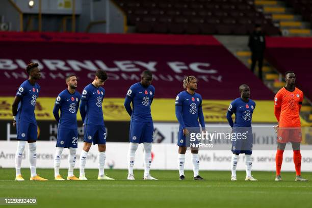 Chelsea players observe a minutes silence for armistice day prior to during the Premier League match between Burnley and Chelsea at Turf Moor Burnley...