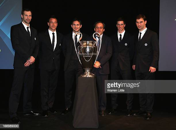 Chelsea players Petr Cech John Terry Frank Lampard UEFA President Michel Plantini Fernando Torres and Branislav Ivanovic pose for a picture during...