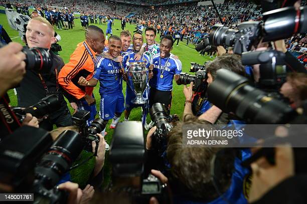 Chelsea players pose with the trophy after the UEFA Champions League final football match between FC Bayern Muenchen and Chelsea FC on May 19 2012 at...