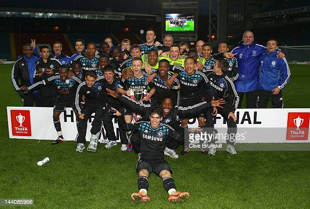 Chelsea players pose with the trophy after victory against Blackburn Rovers during the FA Youth Cup Final 2nd leg match between Blackburn Rovers...