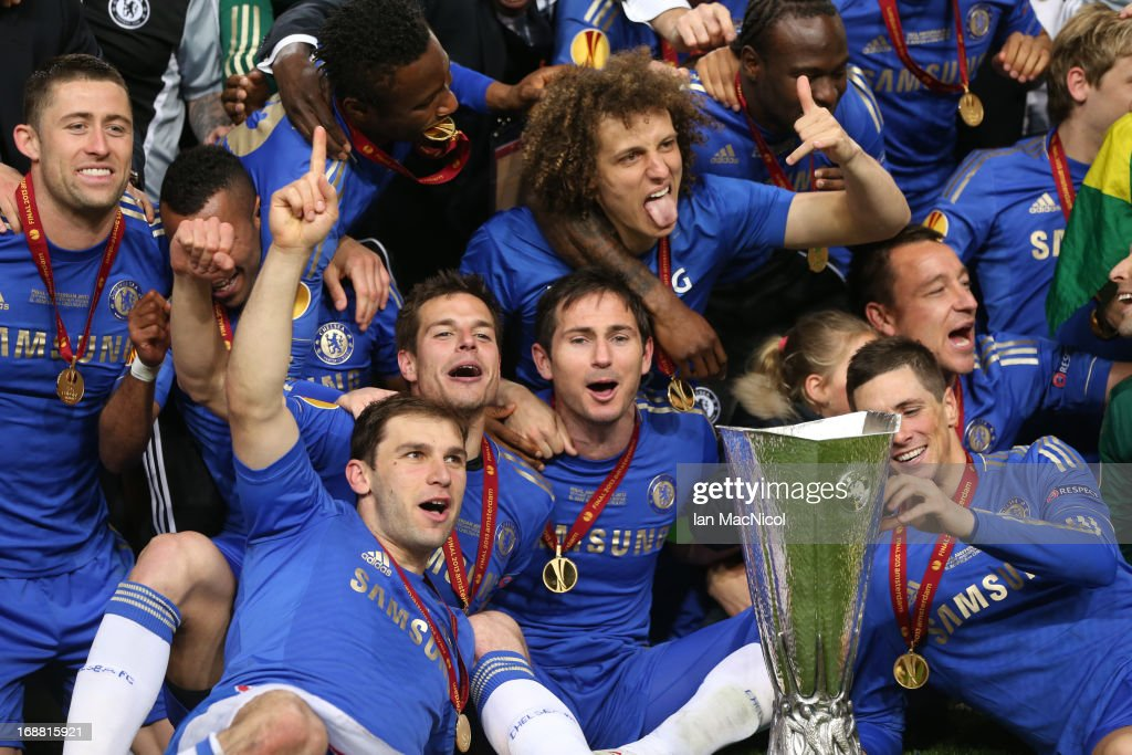 Chelsea players pose with the trophy during the Europa League Final match between Chelsea and SL Benfica at The Amsterdam Arena on May 15, 2013 in Amsterdam, Netherlands.