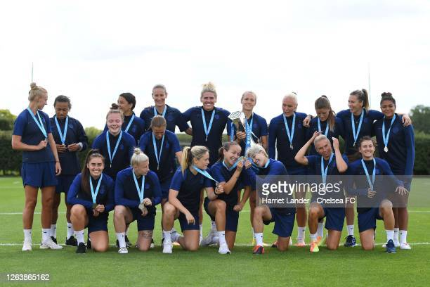 Chelsea players prepare to pose for a photo with the Barclays FA Women's Super League trophy and their winners medals prior to a Chelsea FC Women's...