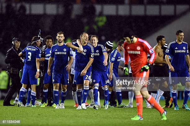 Chelsea players react at the end of the game having beaten Derby County by three goals to one