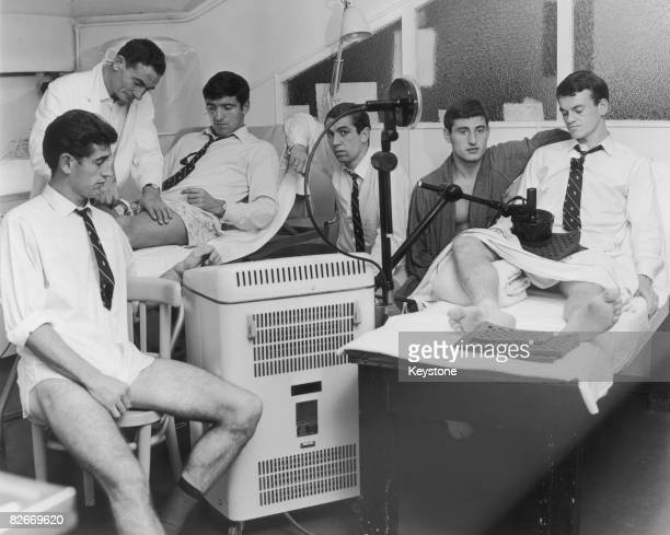 Chelsea players receive treatment for injuries after a Fairs Cup match against Roma at the club's Stamford Bridge ground 8th October 1965 Left to...