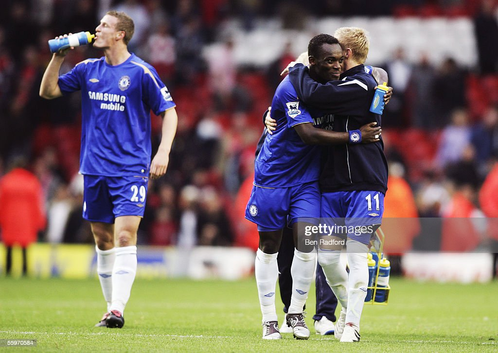Chelsea players (L-R) Robert Huth, Michael Essien and Damien Duff have a drink after the Barclays Premiership match between Liverpool and Chelsea at Anfield on October 2, 2005 in Liverpool, England.