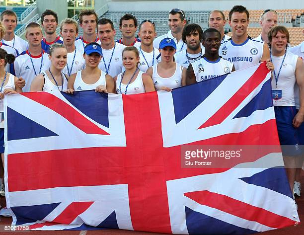 Chelsea players Shaun Wright-Phillips and John Terry pose for a good luck picture with members of the Mens Hockey and Womens Gymnastics Olympic teams...