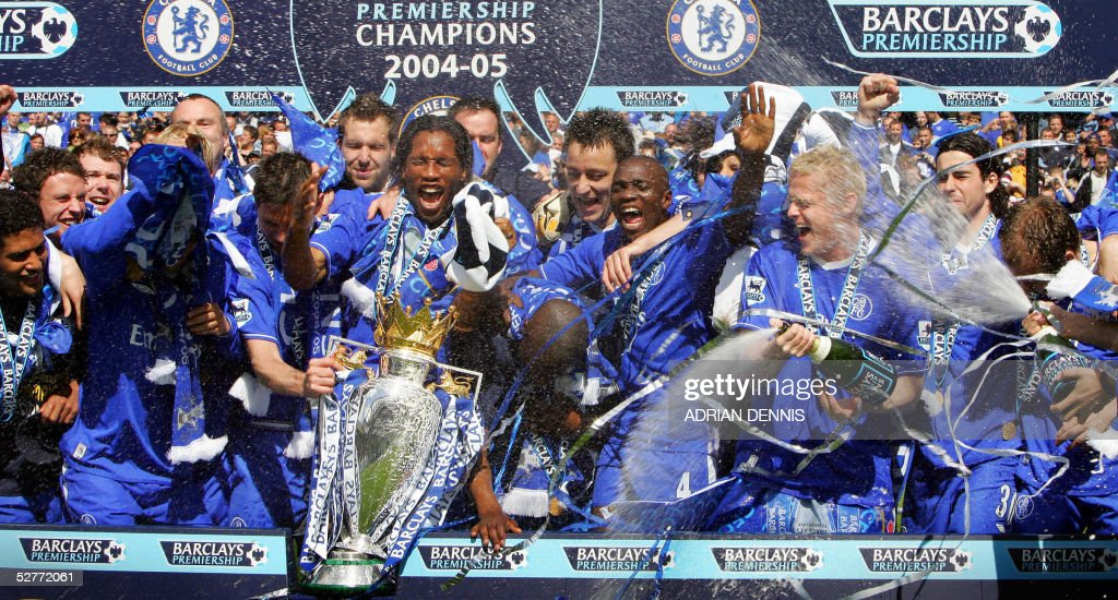 Chelsea players spray champagne over the Barclays Premiership trophy during the celebrations after the game against Charlton at Stamford Bridge in London 07 May 2005. AFP PHOTO Adrian DENNIS No telcos, website uses subject to subscription of a license with FAPL on www.faplweb.com <http://www.faplweb.com>