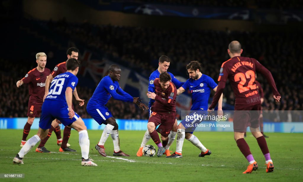 Chelsea players surround Barcelona's Lionel Messi during the UEFA Champions League round of sixteen, first leg match at Stamford Bridge, London.