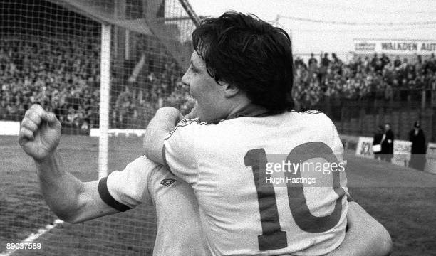 Chelsea players Tommy Langley and Clive Walker celebrate Chelsea's goal during the English Division One match between Bolton Wanderers and Chelsea...