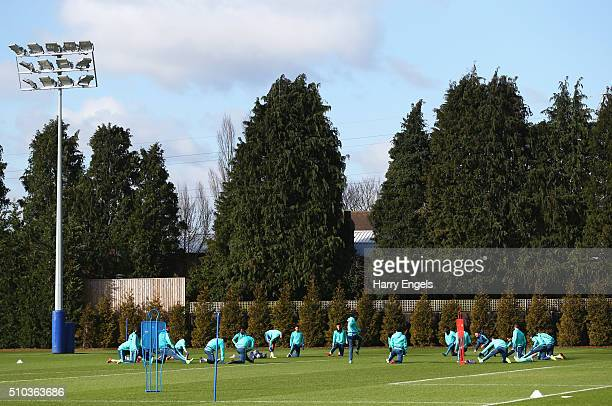 Chelsea players warm up during a Chelsea training session ahead of their UEFA Champions League round of 16 match against Paris SaintGermain at...