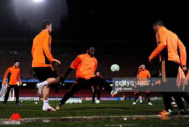 Chelsea players warm up in wet conditions during the Chelsea training session ahead of the UEFA Champions League round of sixteen first leg match...