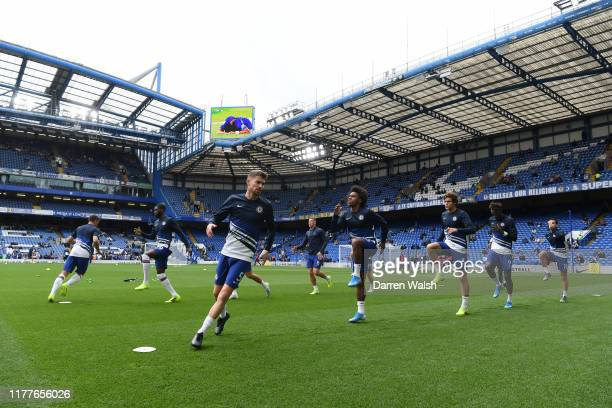 Chelsea players warming up prior to the Premier League match between Chelsea FC and Brighton Hove Albion at Stamford Bridge on September 28 2019 in...