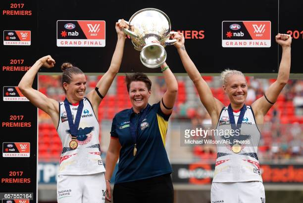 Chelsea Randall Bec Goddard and Erin Phillips of the Crows hold the cup aloft after winning the inaugural AFLW Premiership during the 2017 AFLW Grand...