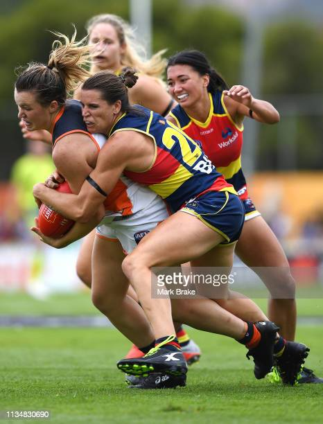 Chelsea Randall of the Adelaide Crows tackles Alyce Parker of the Giantsduring the round six AFLW match between the Adelaide Crows and the Greater...