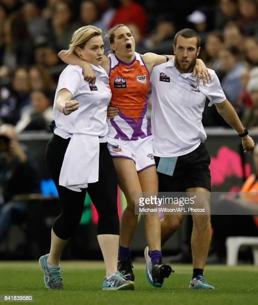 Chelsea Randall of the Allies leaves the field injured during the AFL Women's State of Origin match between Victoria and the Allies at Etihad Stadium...