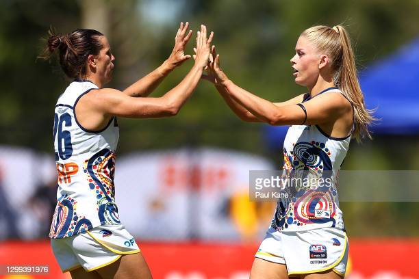 Chelsea Randall of the Crows and Ashleigh Woodland of the Crows celebrate a goal during the round one AFLW match between the West Coast Eagles and...
